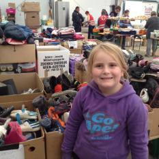 Sorting donated clothes and shoes